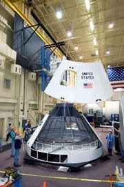 Engineers construct a mockup of the Crew Exploration Vehicle at NASA's Johnson Space Center in Houston, Texas (November 2005).