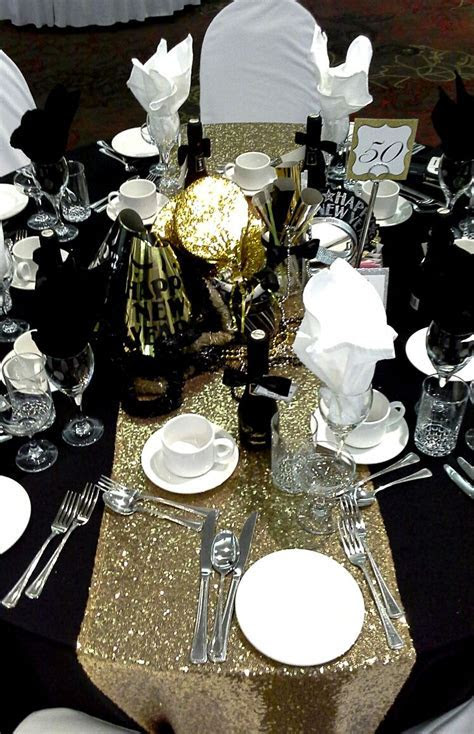 black, gold and silver centerpiece for a black tie affair