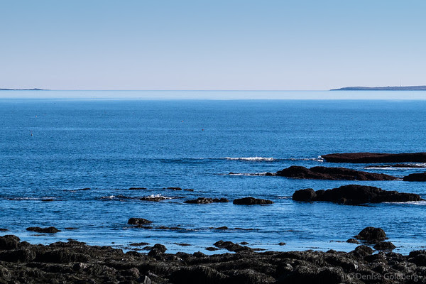 calm seas and blue sky, along the New Hampshire coast