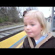Little Girl Gleefully Anticipates her First Train Ride