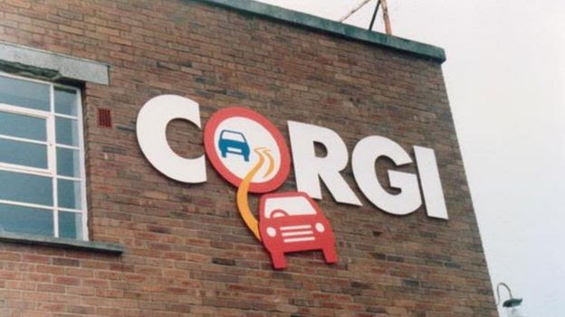 Corgi logo on the side of the brick building