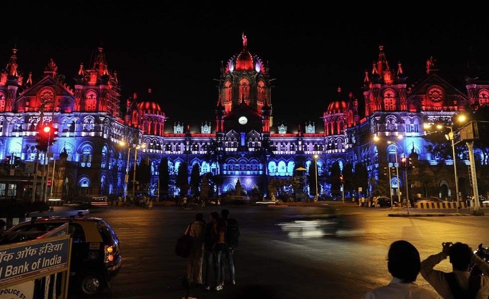 Mumbai's main railway station, the Chhatrapati Shivaji Terminus, is lit up in the colours of the French national flag on November 15, 2015 to express solidarity with victims of the deadly attacks in Paris. For residents of the bustling Indian port of Mumbai, the attacks in Paris on November 13 that left more than 129 people dead, carry sombre echoes of a bloody series of killings in their own city in 2008. A total of 166 people were killed in November seven years ago when Islamist gunmen stormed luxury hotels, the main railway station, a Jewish centre and other sites in the booming metropolis, the financial heart of India. A 20-minute killing spree at Chhatrapati Shivaji Terminus left some 80 people dead. AFP PHOTOSTR/AFP/Getty Images