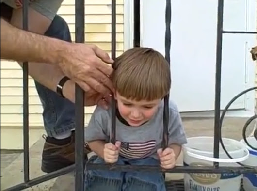 Kid gets head unstuck from fence bars