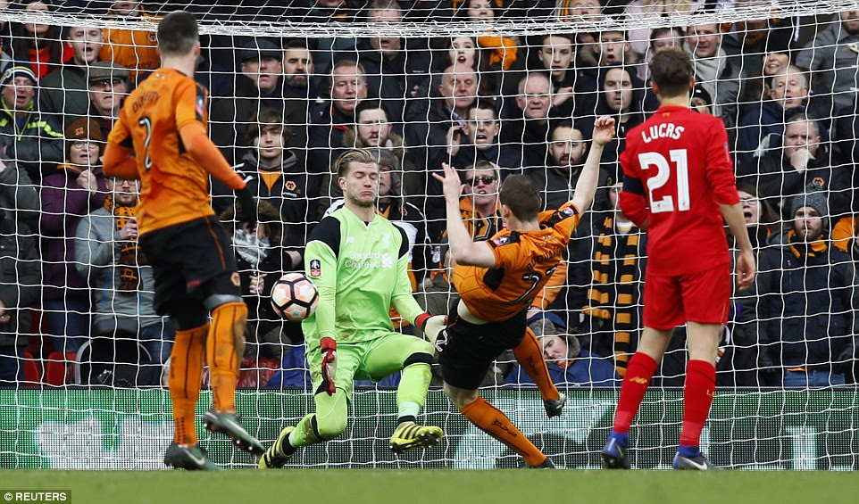 Karius makes himself big and blocks the effort on goal by Jon Dadi Bodvarsson as Wolves aim for a third goal