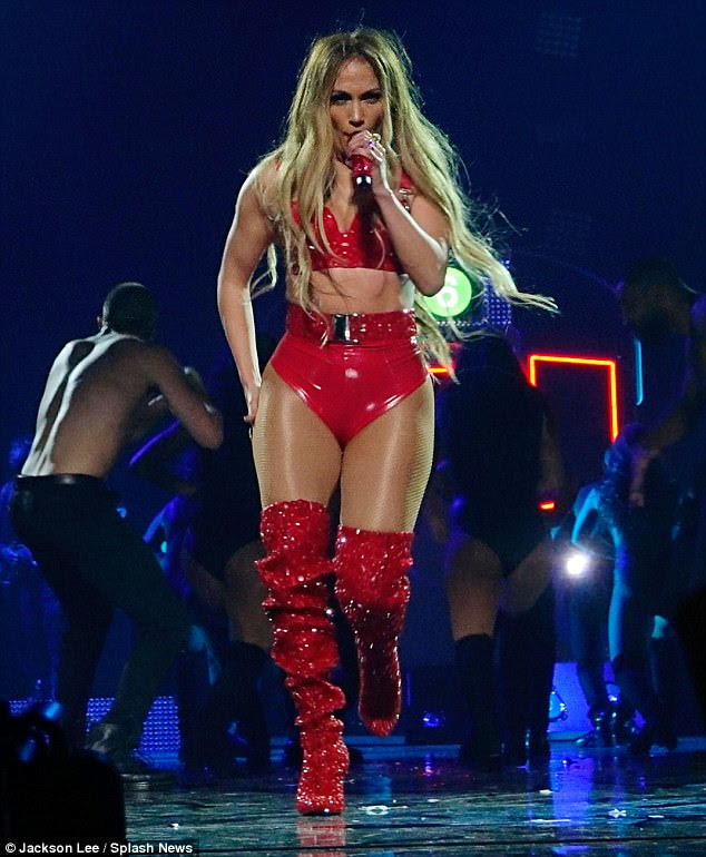 Revealing: Stripping down to an embellished red PVC lingerie, Jennifer fully exposed her curvy physique while effortlessly working her way through a series of accomplished dance moves
