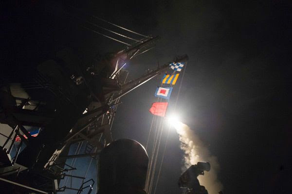 A Tomahawk cruise missile is launched from a U.S. Navy destroyer out in the Mediterranean Sea to strike a Syrian military airfield...on April 6, 2017.