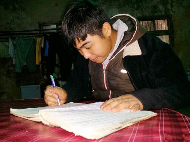 Guide to life: Chen Hongzhi, 25, has had to write everything down after he suffered brain injuries that left him with a five-minute memory, when he was 17