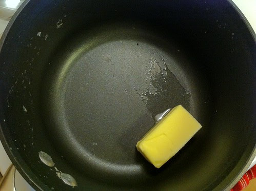 Melting 4 Tablespoons of Unsalted Butter in Pan