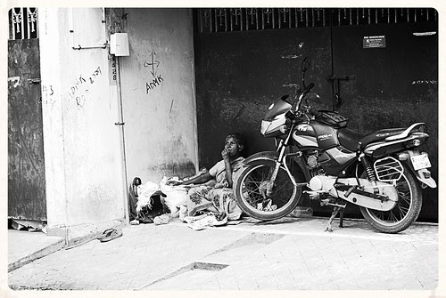 a second hand bike is more expensive than a poor woman by firoze shakir photographerno1