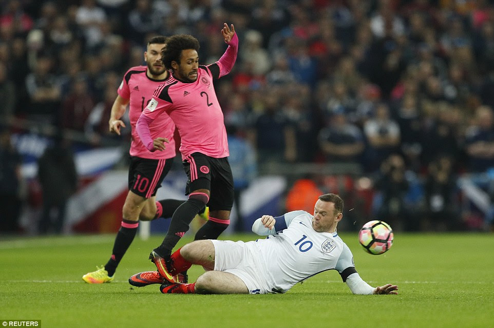 England captain Rooney, recalled to the starting XI by Gareth Southgate, puts in a tackle on Ikechi Anya