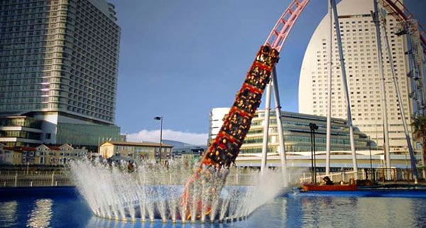 The Vanish roller coaster is about to enter a large pool of water at Yokohama Cosmo World in Japan.