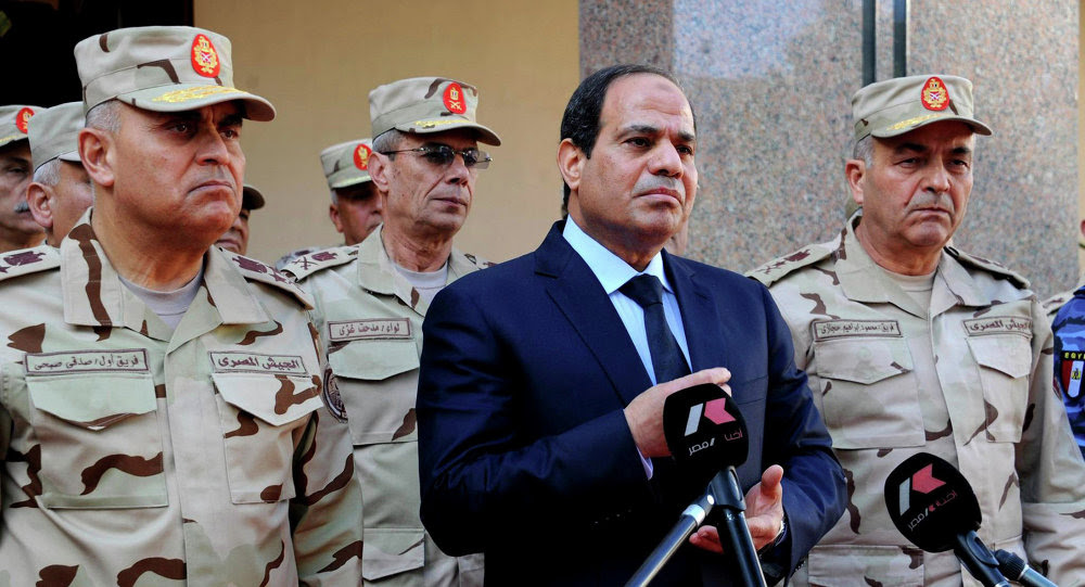 Egyptian President Abdel Fattah al-Sisi (C) talks to the media next to top military generals after an emergency meeting of the Supreme Council of the armed Forces in Cairo, in this January 31, 2015