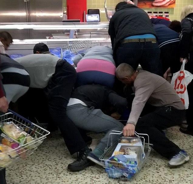 Tesco shoppers wrestle on Northampton supermarket floor over discount food