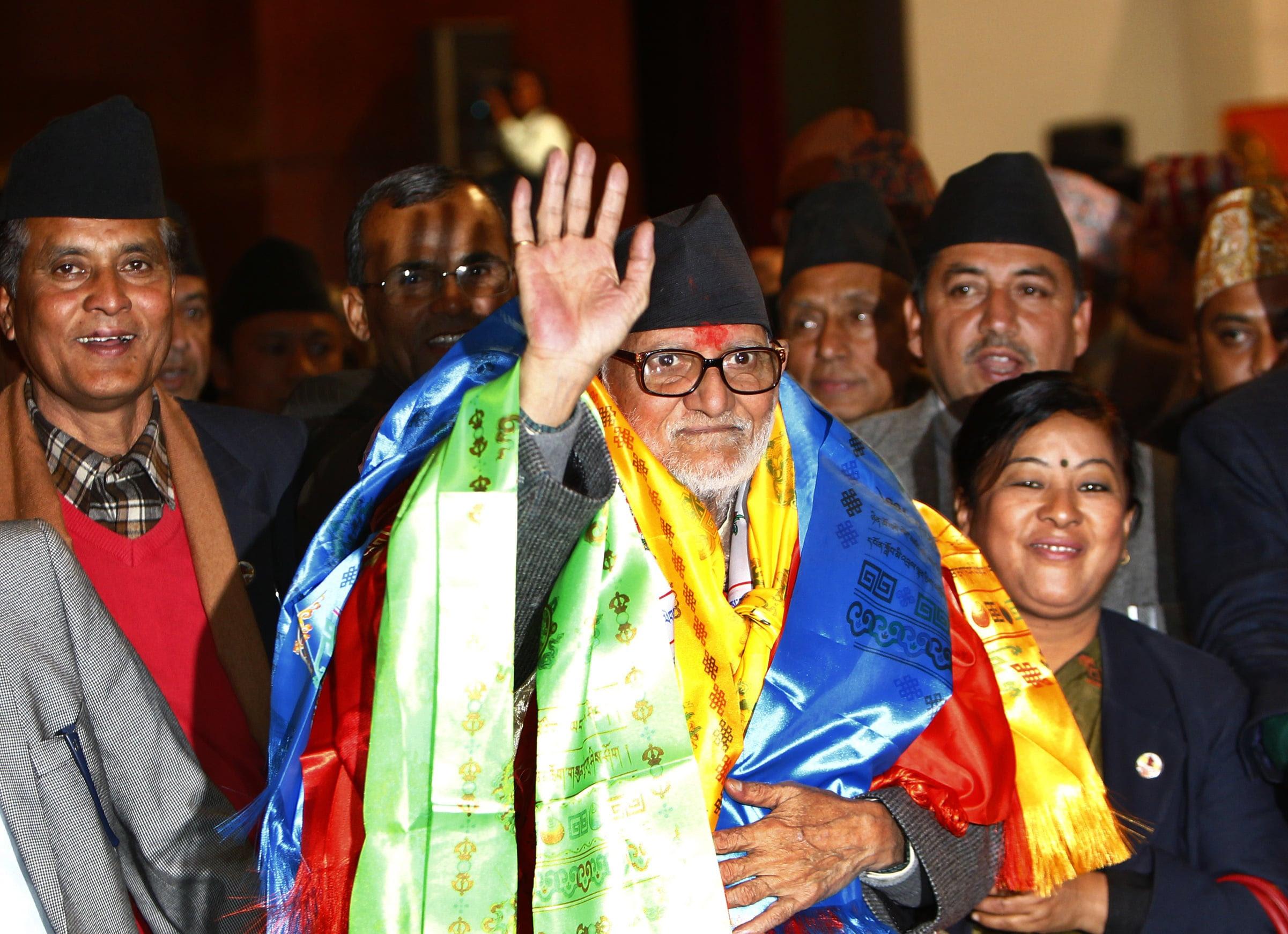 Nepal's newly elected Prime Minister Sushil Koirala waves to the media at the Constitution Assembly Hall, in Katmandu,  Nepal, Monday, Feb.10, 2014. (AP Photo/Niranjan Shrestha)
