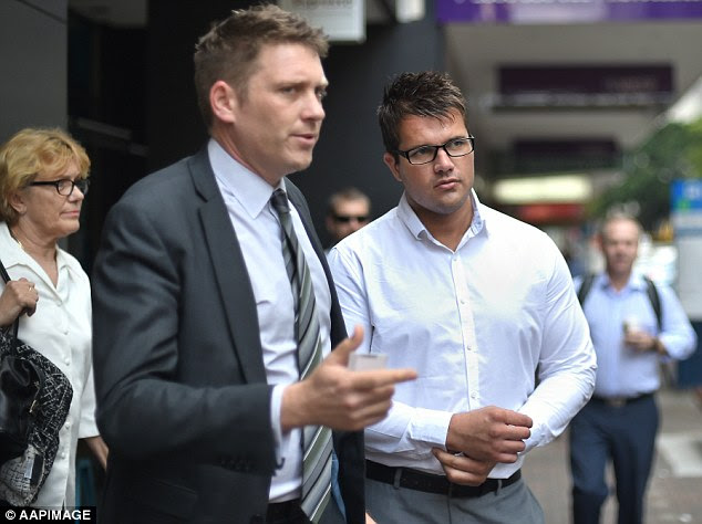 Lawyer Nick Dore (foreground) has told media Mr Tostee did not express sympathy to Warriena Wright's family before the trial because Mr Dore did not want it to be misconstrued