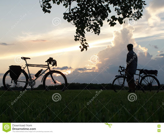 Mountain bike and man with touring bicycle