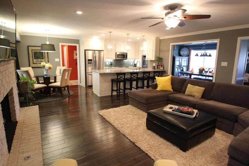 Contemporary Great Room with Hardwood floors, Built-in bookshelf, Chatsworth leather storage ottoman - brown, Ceiling fan