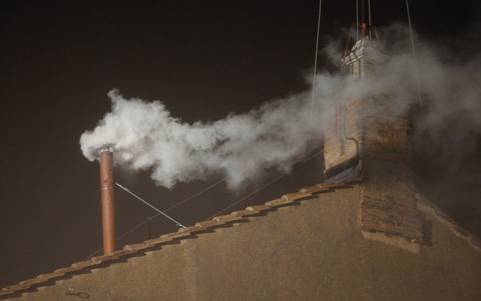 Decision made: White smokes billows from the chimney on the Sistine Chapel indicating that a new Pontiff has been elected by Cardinals