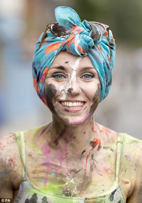 A woman splattered with paint.