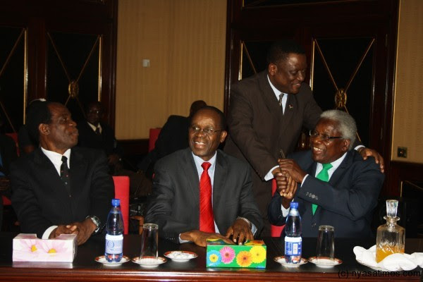 AFORD's Khwauli Msiska hugs Gwanda Chakuamba at Kamuzu Palace