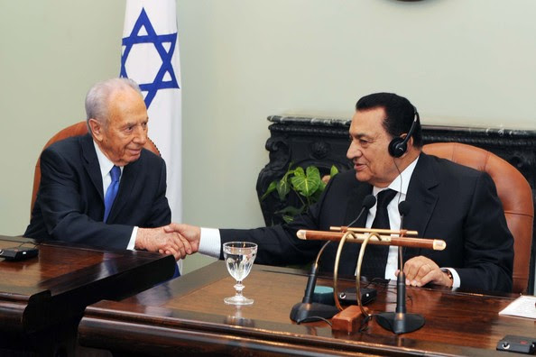 In this handout image provided by the Israeli Government Press Office (GPO), Israeli President Shimon Peres (L) shakes hands with Egyptian President Hosni Mubarak during a press conference on July 7, 2009 in Cairo, Egypt. Peres and Mubarek discussed a number of issues including Israeli settlement activity, the possibility of achieving a two state solution involving the Palestinians and the situation of Israeli soldier Gilad Shalit who was captured by Hamas in 2006.