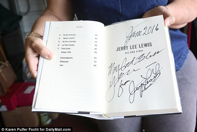 An autographed copy of the musician's autobiography, Jerry Lee Lewis: His Own Story, was one of the hundreds of items on sale on Friday