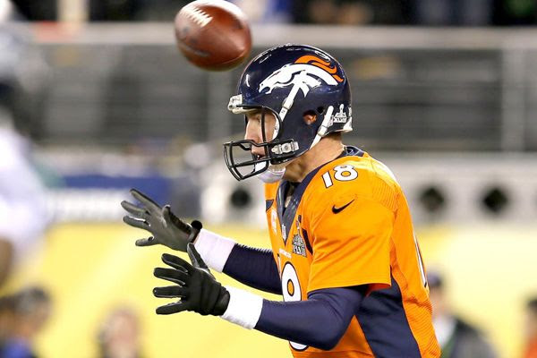 The football flies above Peyton Manning's head as the Denver Broncos err on the first play of Super Bowl XLVIII, on February 2, 2014.
