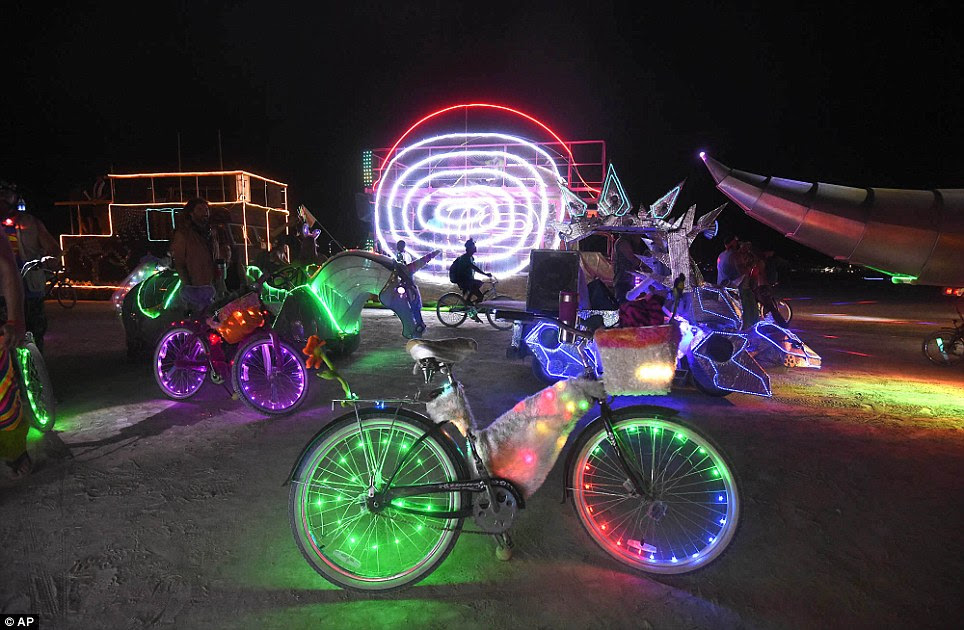 Ready to rock: A Burning Man participant's bike is surrounded by art cars that are lined up at the Black Rock DMV to be registered at Burning Man on the Black Rock Desert of Gerlach, Nevada