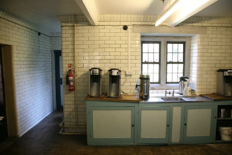 White tiled kitchen with 50's style kitchen units and adjacent ...