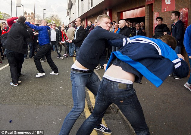 Ugly scenes: One fan appeared to throw a punch as scenes turned ugly outside Anfield