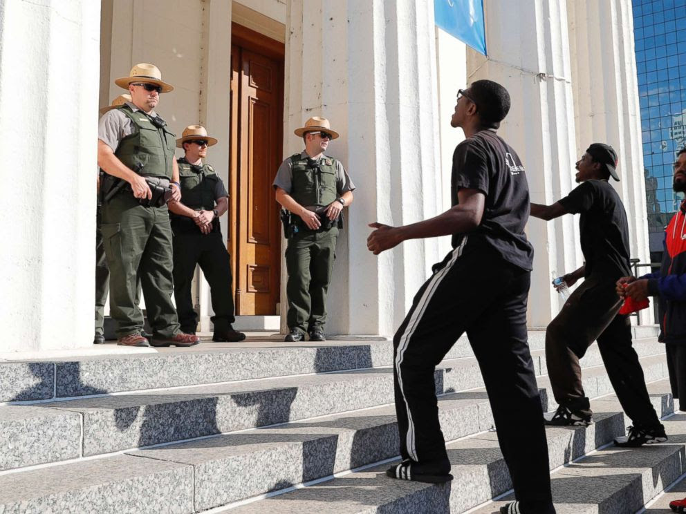 PHOTO: Protesters yell at law enforcement officers on the steps of the Old Courthouse following a verdict in the trial of former St. Louis police officer Jason Stockley in St. Louis on, Sept. 15, 2017.