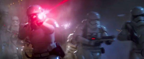 First Order Stormtroopers open fire on Jakku villagers (off-screen) in STAR WARS: THE FORCE AWAKENS.