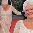 Still stunning at 78! Dame Judi Dench wows at Venice Film Festival in elegant ivory gown... as she shows how to elegantly flash a leg