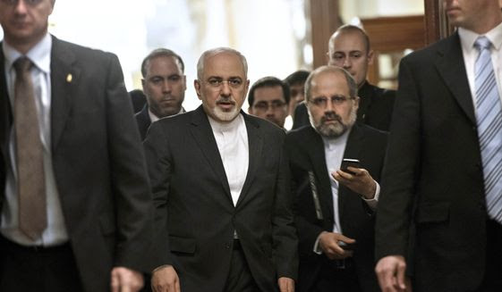 Iranian Foreign Minister Mohammad Javad Zarif, center, leaves a meeting with U.S. Secretary of State John Kerry and other U.S. officials at a hotel in Lausanne, Switzerland, in this March 26, 2015, file photo. (AP Photo/Brendan Smialowski, Pool)