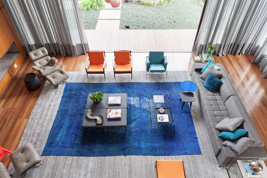 Rug on Rug Decorating Done Right in This Living Room