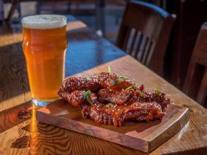 "Korean Fried Chicken Necks with a ""House IPA"" by Berryessa Brewing at the Half Orange in Oakland, Calif. is seen on December 26th, 2014."