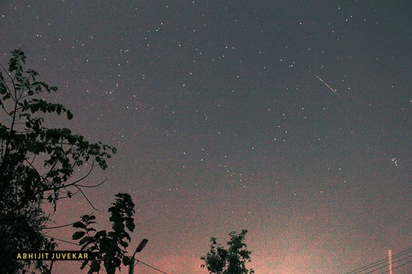 A North Taurid meteor seen fleeing its radiant point near the Pleiades in the constellation Taurus.  Captured by EarthSky Facebook friend Abhijit Juvekar on November 12, 2013.  Thank you, Abhijit!