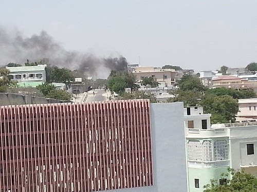 Smoke from the bomb blast at the Somalia presidential villa in Mogadishu. Nine people have been reported killed in the attack. by Pan-African News Wire File Photos