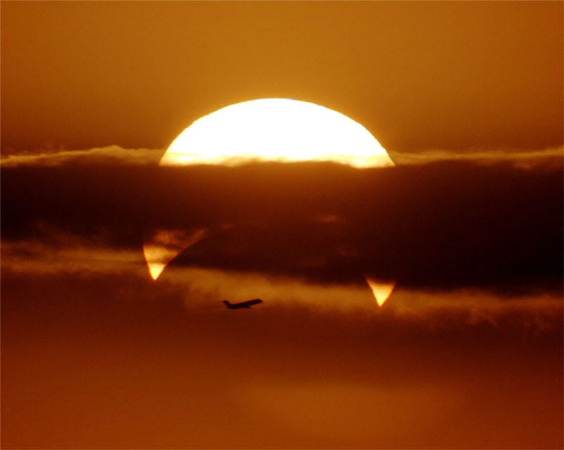 http://twistedsifter.com/2013/06/flyby-partial-solar-eclipse/