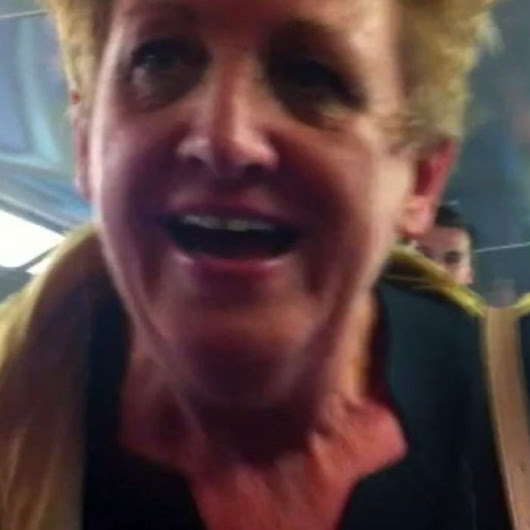Woman charged over racist tirade on Sydney train