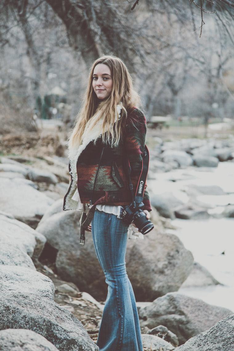 Photo of beautiful bohemian girl in rocks in boulder colorado