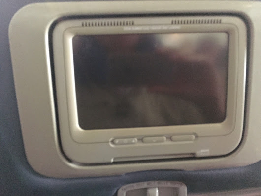 Design Dabbling — This headrest entertainment unit in a Delta flight...
