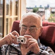 old person with camera