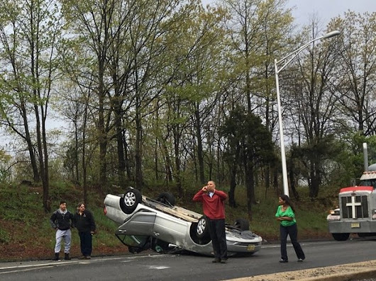 Car flips on NJ Turnpike ramp, closing lane