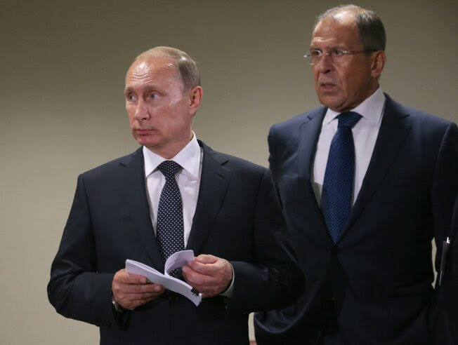 Russian President Vladimir Putin stands with Foreign Minister Sergei Lavrov, right, during a meeting in the UN Headquarters on Sept. 28, 2015, in New York City.