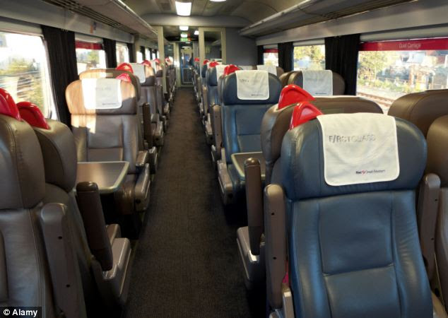 End of the line: Empty seats on a first class Great Western carriage travelling from London. Ministers are considering asking train companies to convert them for use by standard ticket holders
