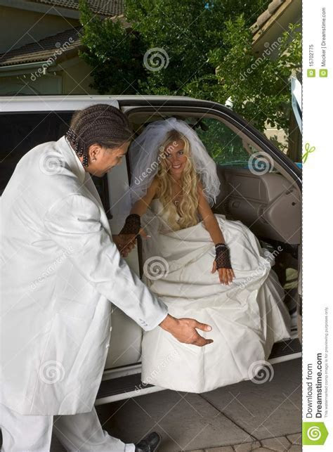 Young Bride In Wedding Dress Getting Off Car Royalty Free