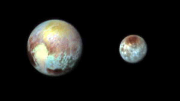 A false-color image of Pluto and Charon that was taken by NASA's New Horizons spacecraft on July 13, 2015.