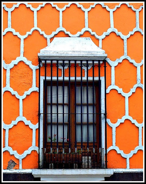 An exterior in Mexico. Love the color and shape. Would be awesome in a wallpaper for a bathroom or something.