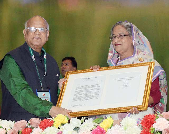 Finance Minister AMA Muhith handed a replica of the UN's recognition letter to Prime Minister Sheikh Hasina Wazed at a reception accorded to her in the capital.